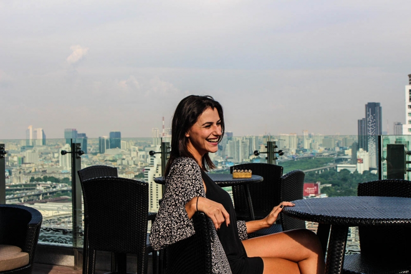 Woman smiling checking the view of the hotel Amari Watergate Bangkok.