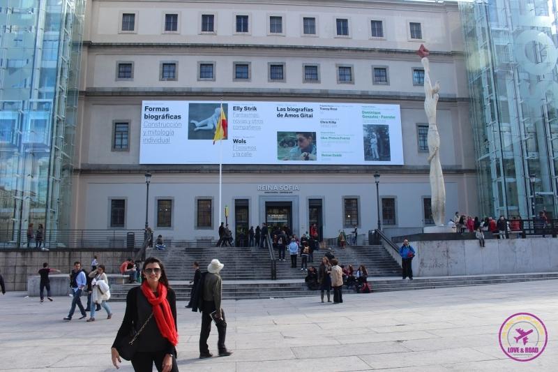 Woman posing in front of the Museo Nacional Centro de Arte Reina Sofía, in Madrid.