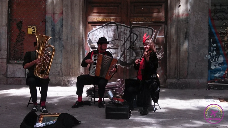 Musicians playing music on the street of Madrid.