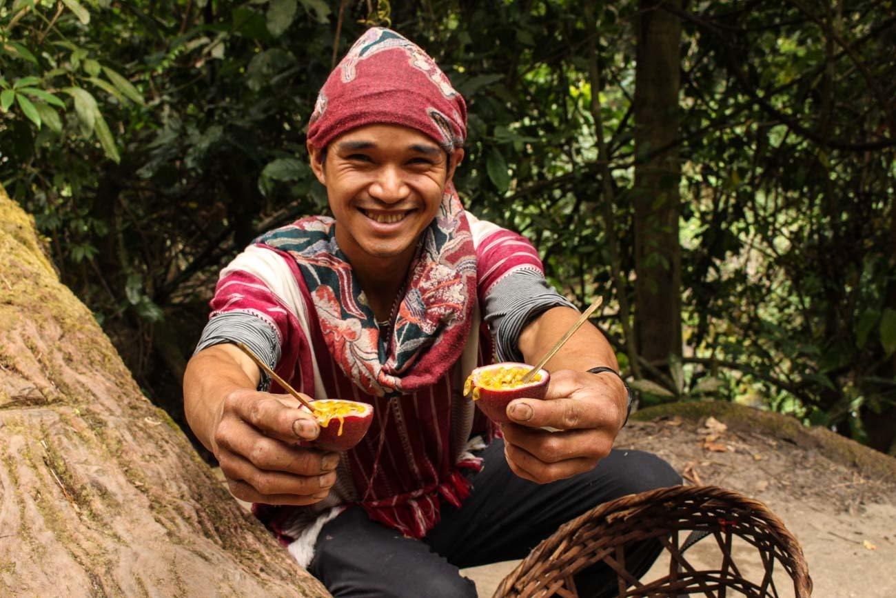 Guide serving passion fruit on expedition to the Chiang Mai mountains.