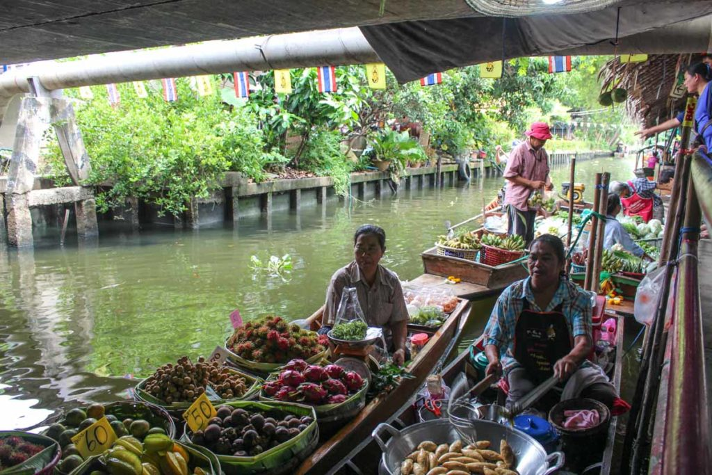 Visiting a traditional floating market is one of the best local experience you can have on your first time in Bangkok.