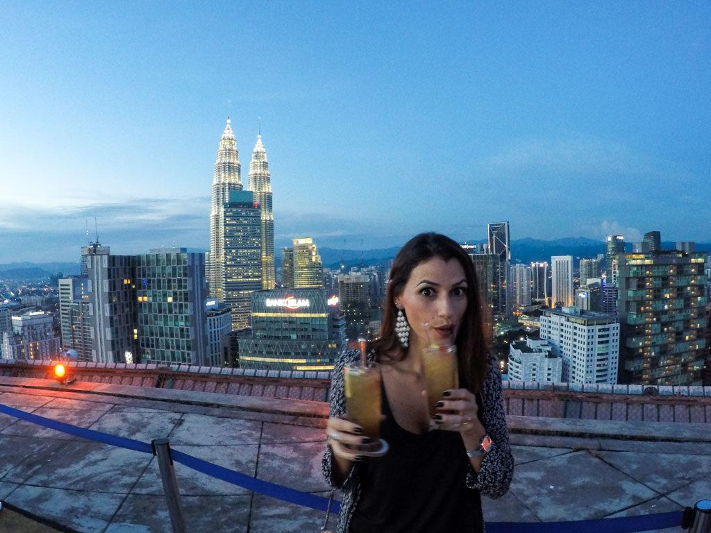 My secret travel tip for your one day in Kuala Lumpur is: cocktails on a Heliport with a stunning view.