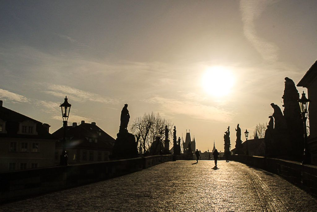 On of the travel tips to cool things to do in Prague is visit the Charles Bridge early in the morning.