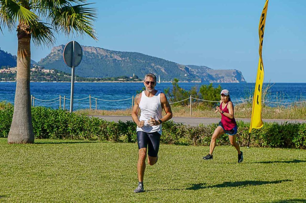 Man and woman running at bootcamp in Spain