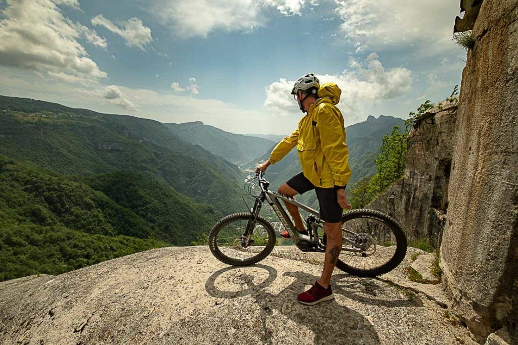 Cyclist enjoying the views from a mountain bike trail in Alpe Cimbra.
