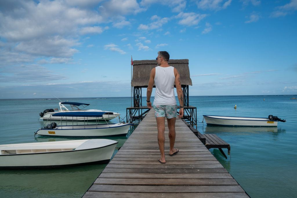 Man walking on a pier in Mauritius.