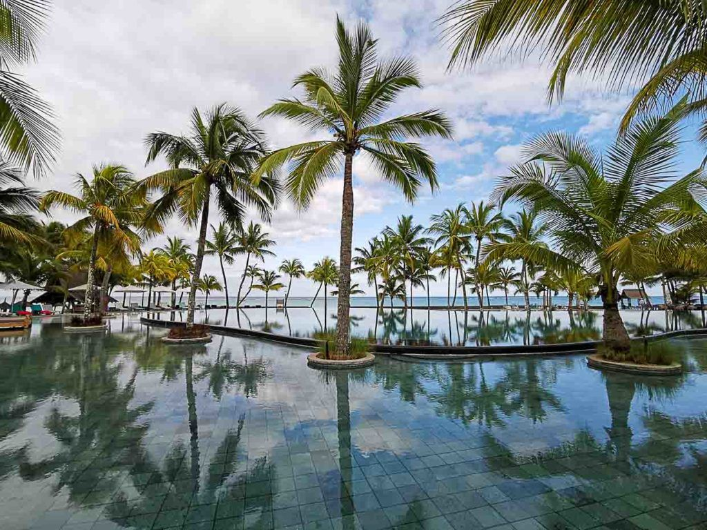 Photo of hotel in Mauritius with a huge pool facing the beach.