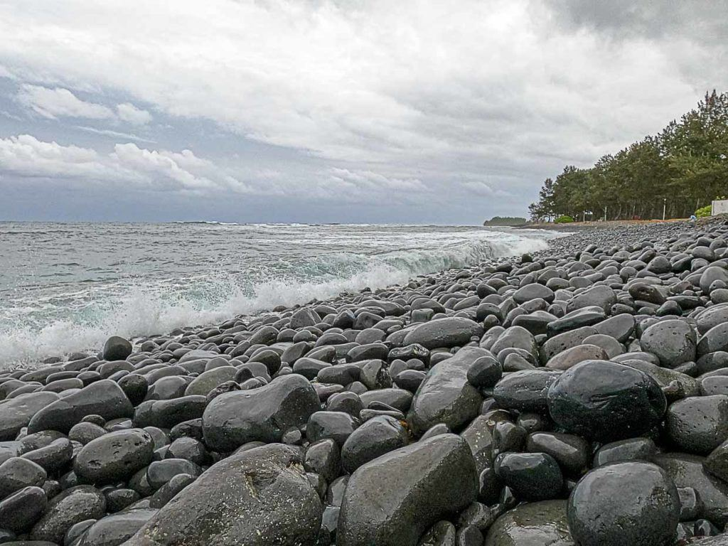 The Riviere des Galets Beach is unique with its black pebbles stones