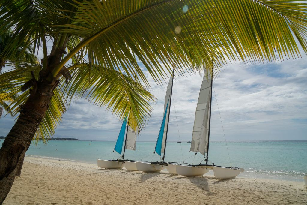 Picture of Mauritius beach with three small catamarans on the sand.