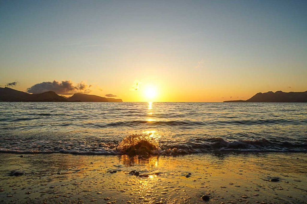 One of the top things to do in Puerto Pollensa is to watch the sunrise at the beach.