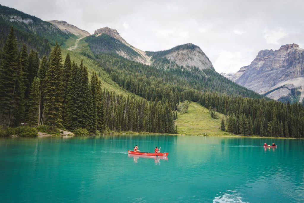 An emerald lake with smalls boats, a famous attraction in the National Parks.