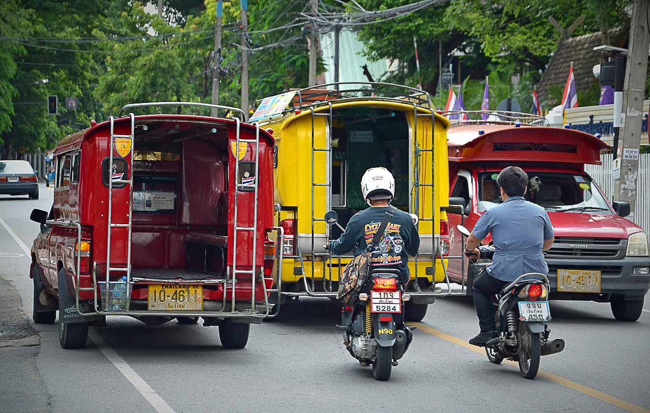 Photo of two songthaews, the Thai buses that run inside cities, or between villages.
