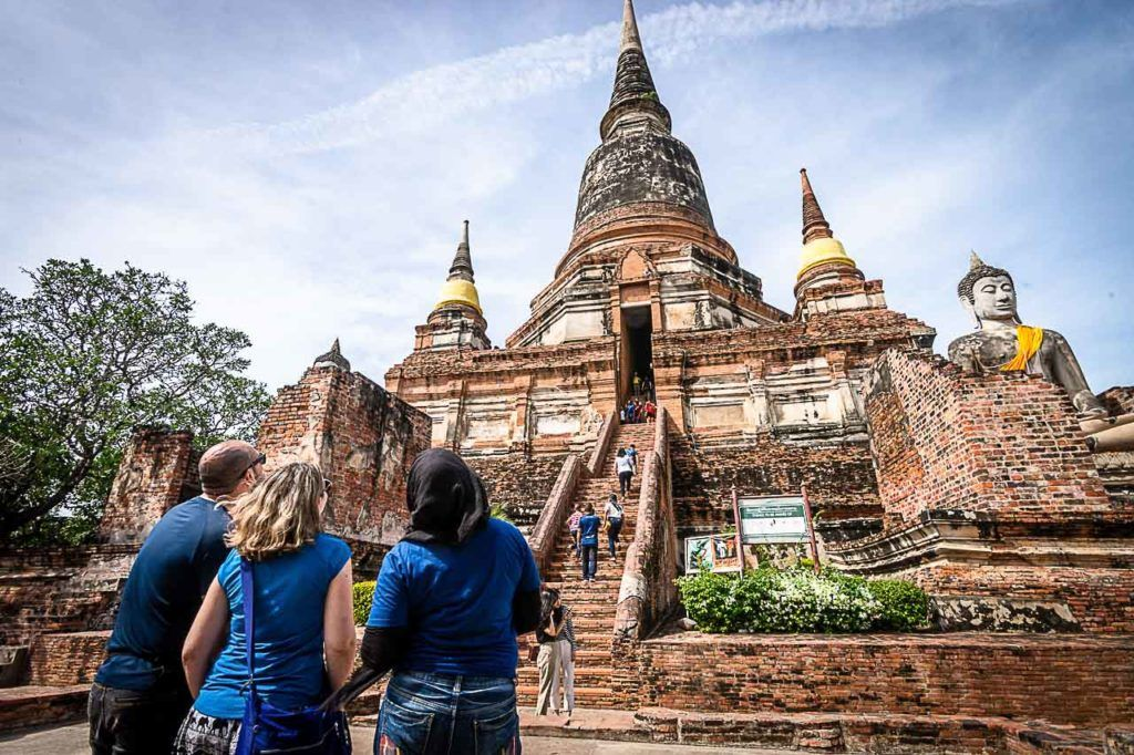 Travelers looking at one of the temples in Ayutthaya Historical Park.