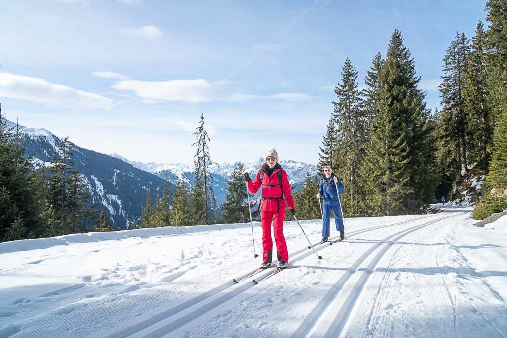 Couple skiing on trip to Montafon, in Vorarlberg, Austria.