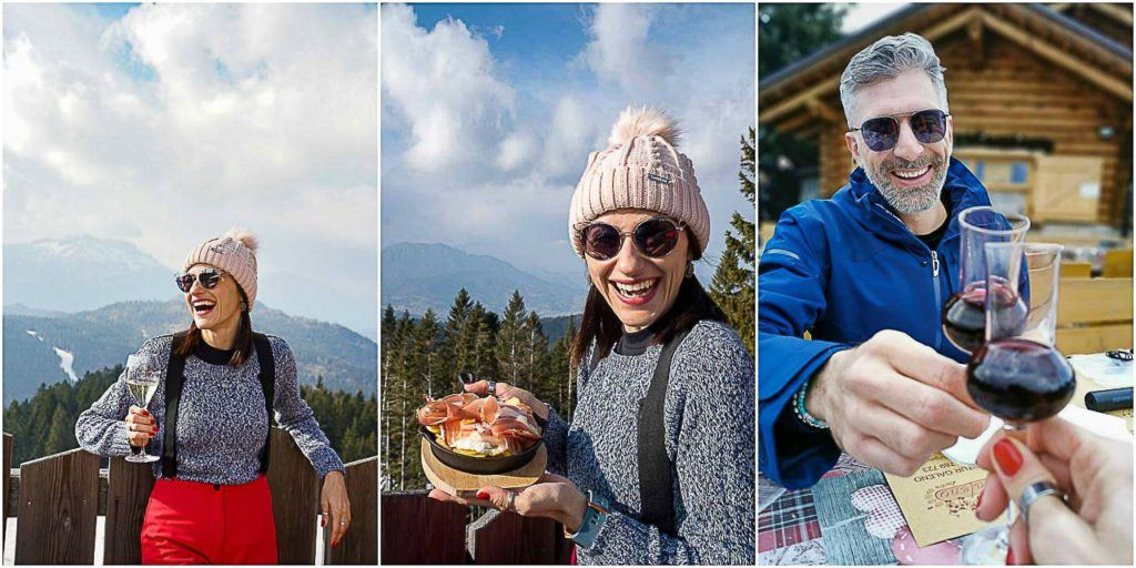 Casal Love and Road desfrutando vinho e comida no Rifugio Baita del Neff, na área de esqui de Lavarone.