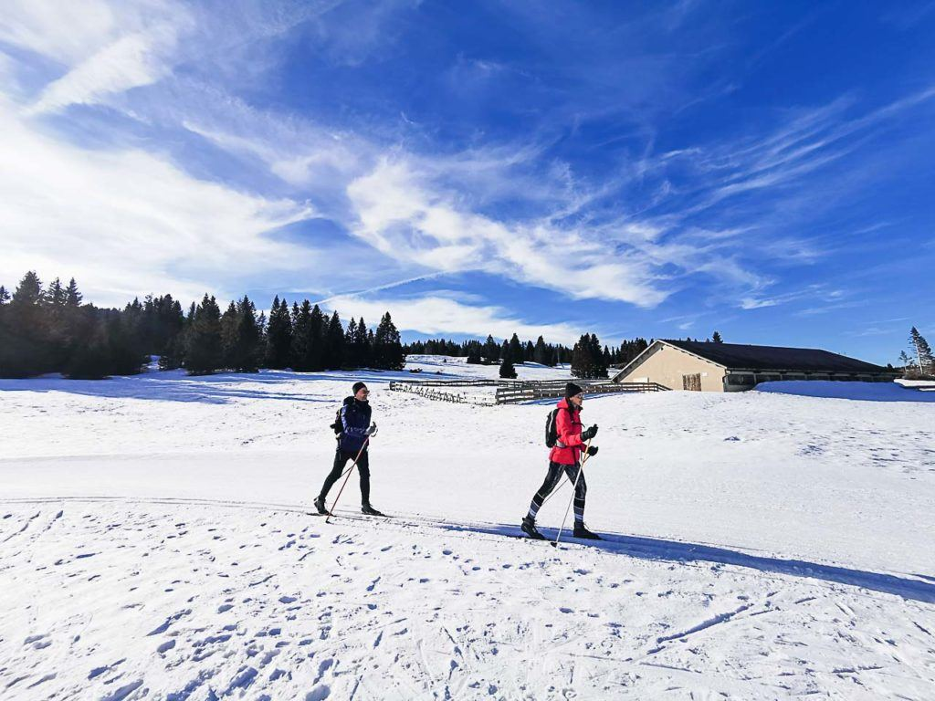 Couple cross country skiing in Passo Coe, Folgaria Ski Area.