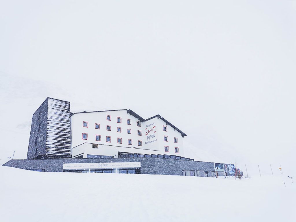 The Berggasthof Piz Buin Hotel, in Gaschurn, surrounded by snow.