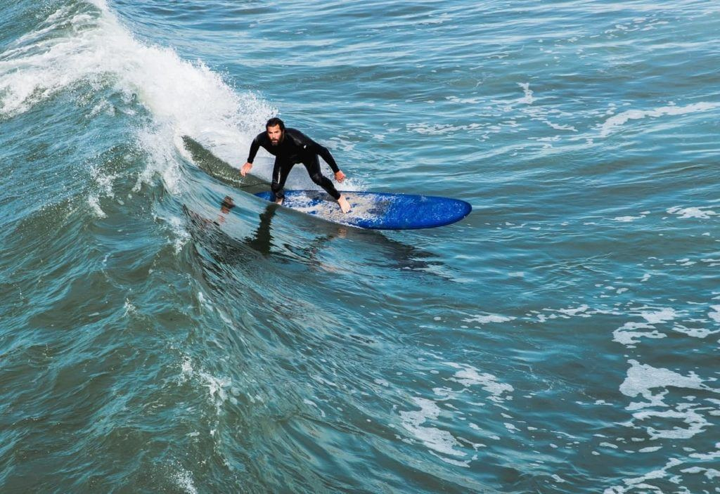 Surfer at La Jolla Shores Beach, which is one of the best places to take surf lessons in San Diego.
