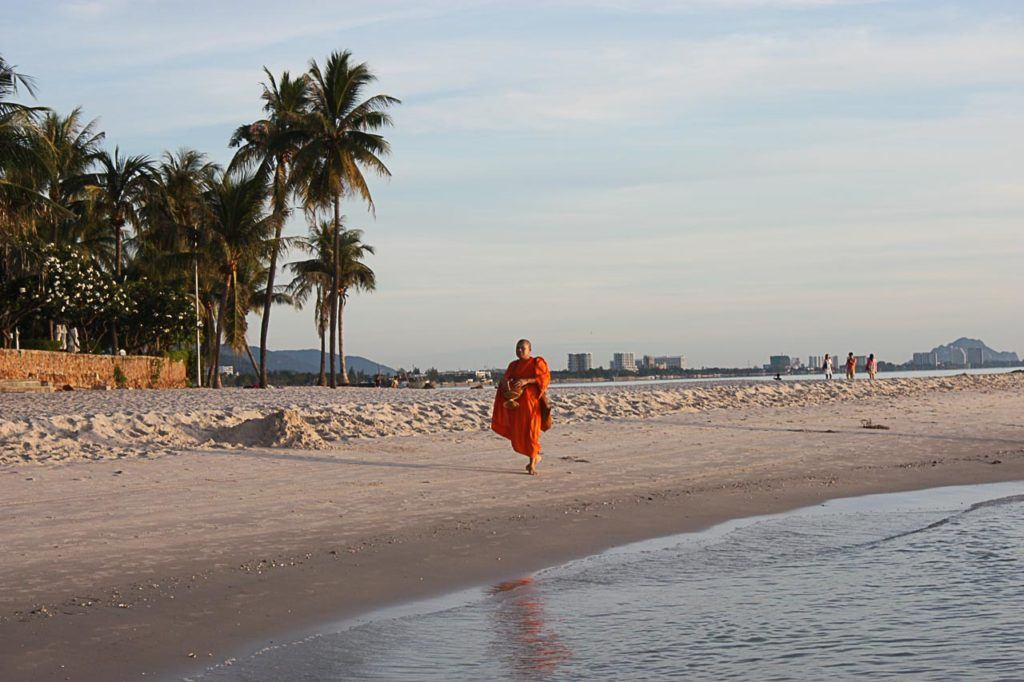 A monk walks on the beach in Hua Hin, Thailand.