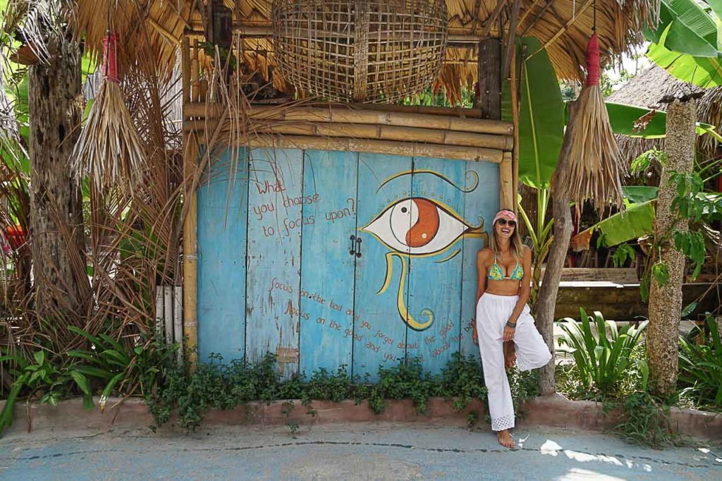 Woman posing in front of a hotel in Koh Lipe, Thailand.