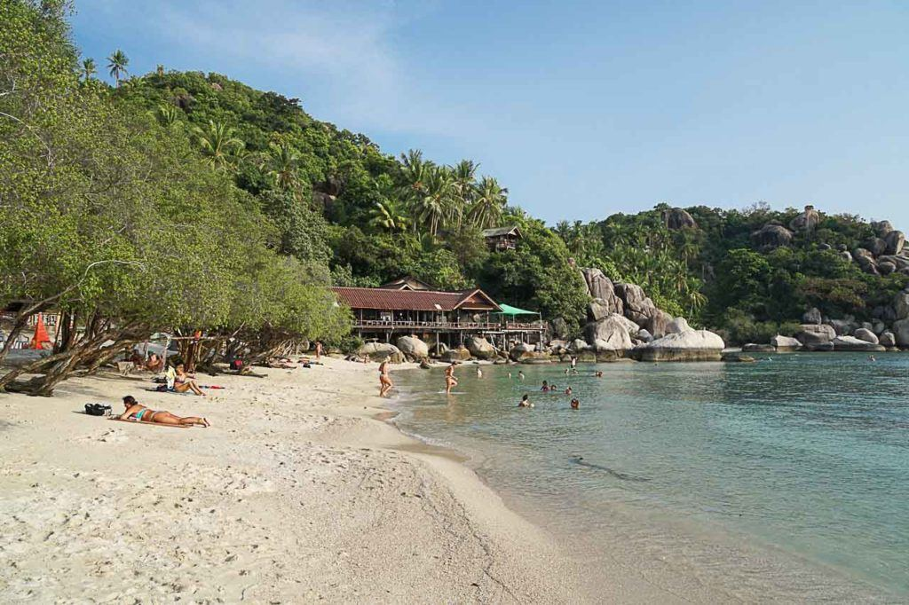 People enjoying a beautiful Freedom Beach in Koh Tao.