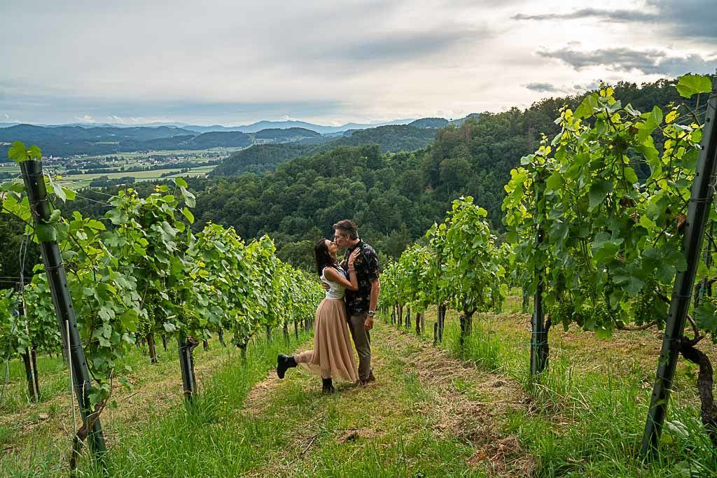 Love and Road couple surrounded by vineyards on a day trip from Graz to the South Styrian region.
