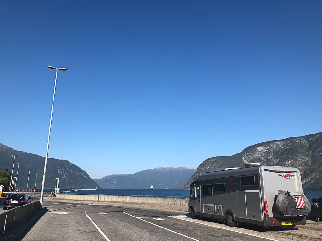 Motorhome drive on the highway in Norway. Discover all the information you need to consider when planning a road trip in Norway in this article.